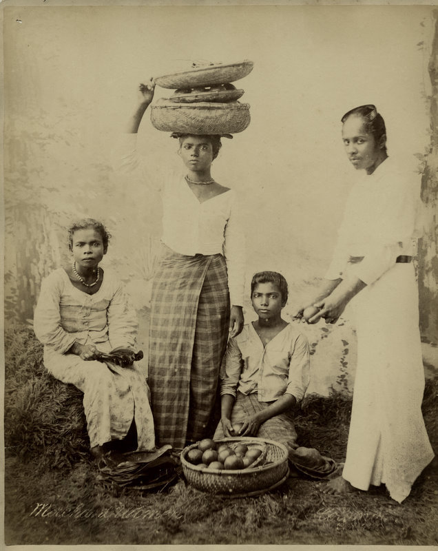 Albumen photograph of a family with food - 1890s