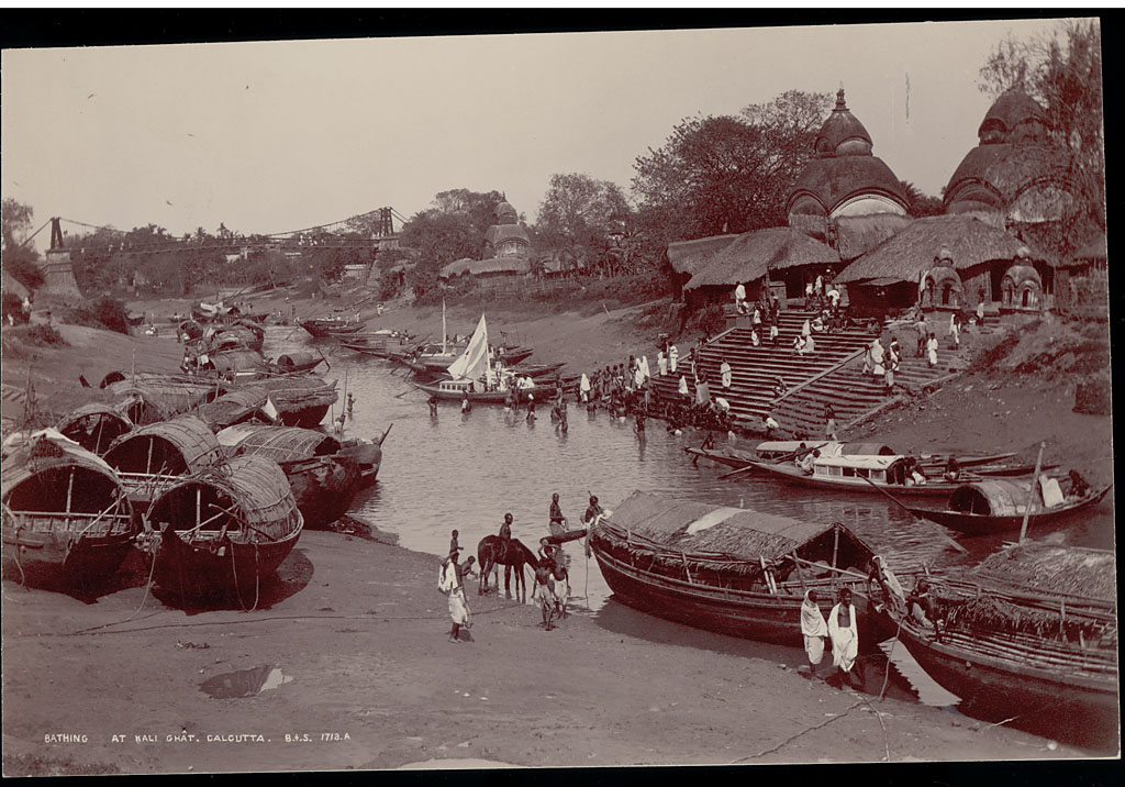 Bengal group Bathing at Kali Ghat Near Boats on River And Ashore, Suspension Bridge in Distance - Samuel Bourne 1863