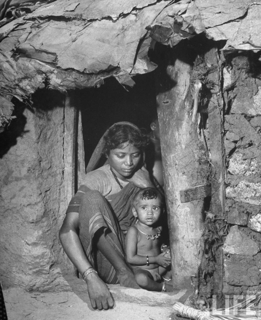 Young Indian Woman with her Child in Doorway of Shack in the Chawls (quarters for the Untouchables) in the Poor Section of the City - Bombay (Mumbai) 1946