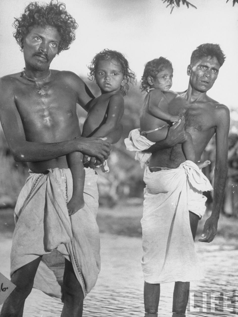 Men of the Untouchables Caste, Holding their Daughters - Poodalur 1946
