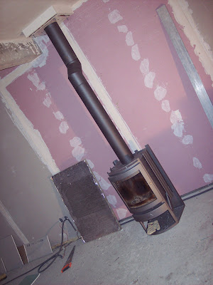 notre maison en autoconstruction tubage du conduit et montage du poele. Black Bedroom Furniture Sets. Home Design Ideas