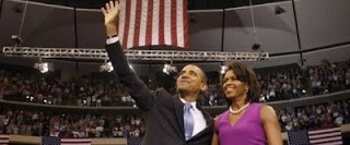 Barack and Michelle Obama during victory speeach
