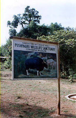 A board depicting Pushpagiri wildlife sanctuary in Kodagu (Coorg) District along the trek to Kumara Parvata peak from Beedihalli