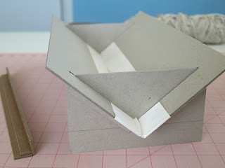 Punching cradle made from book board for book binding
