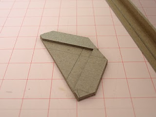 Corner trimming tool to trim book cloth in book binding