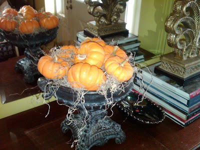 mini pumpkins in the front entry