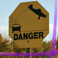 danger sign: plane and car