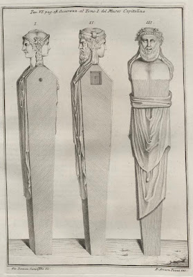 Three plinths crowned with human heads