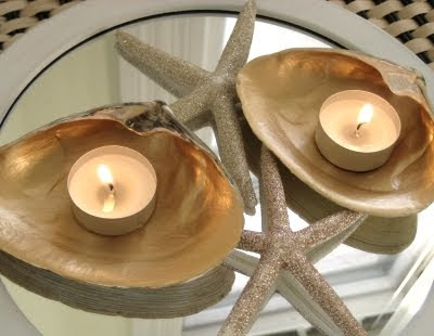 gold painted shells as tea light candle holders