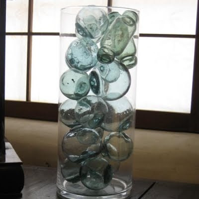 glass floats in vase