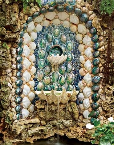 shell covered garden fountain