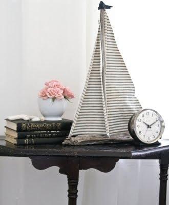 handmade driftwood sailboat with ticking fabric