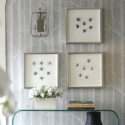 use silver starfish and shells as wall art