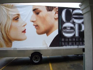 Mobile Billboard of Intimate Couple