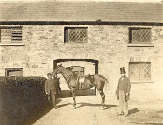 Stables at Kilrush House. Johnny Byrnes holding a horse at the stables of Kilrush House with Col Crofton Moore Vandeleur on the right. 1860