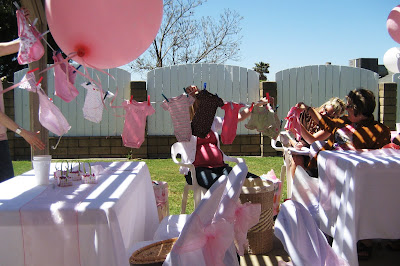 Baby shower ideas images for Baby shower clothesline decoration