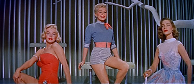 [800px-Marilyn_Monroe,_Betty_Grable_and_Lauren_Bacall_in_How_to_Marry_a_Millionaire_trailer.jpg]