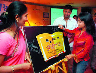 actor , anchor jhansi in the siksha program with sreya and sumanth