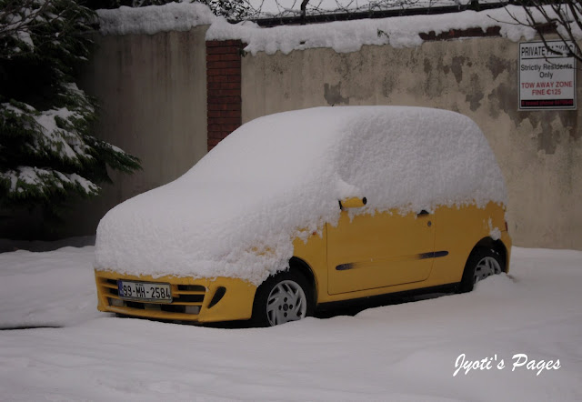 A snow covered car Dublin Ireland
