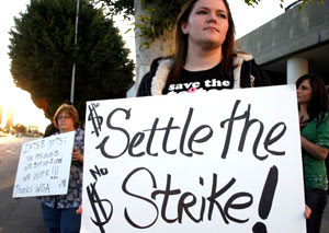 People demonstrate against the writers' strike outside the Beverly Hilton where the Golden Globes awards were announced at a press conference.