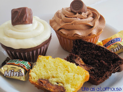 Candy Bar Cupcakes are chocolate and vanilla cupcakes filled with different candy bars and covered in a Quick and Delicious Buttercream Frosting. Life-in-the-Lofthouse.com