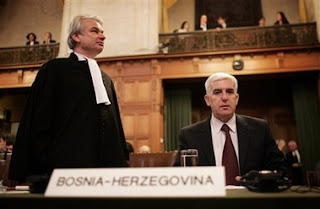 Bosnian Attorney Phon van den Biessen, left, and Bosnian agent Sakib Softic, at the International Court of Justice, also known as the World Court, in The Hague, the Netherlands, Monday Feb. 26, 2007. The United Nations' highest court ruled that Serbia failed to use its clear influence with Bosnian Serbs to prevent the genocide of Bosnian Muslims at Srebrenica, but exonerated Serbia of direct responsibility for genocide or complicity in genocide in Bosnia during the 1992-95 war. The court began delivering a historic ruling Monday on whether Serbia is responsible for genocide through the killing, torture, rape and expulsion of Bosnian Muslims. It is the first time an entire nation is being held to judicial account for the ultimate crime.