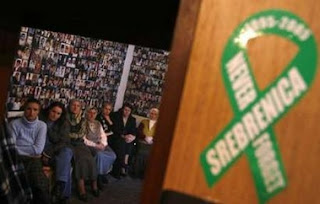 Women from Srebrenica react to television coverage from the The International Court of Justice in front of a wall covered with pictures of their missing loved ones in an office in Tuzla February 26, 2007. The top U.N. court ruled on Monday that Serbia did not commit genocide through the killing that ravaged Bosnia during the 1992-95 war, but said Serbia had failed in its obligation to prevent and punish genocide.