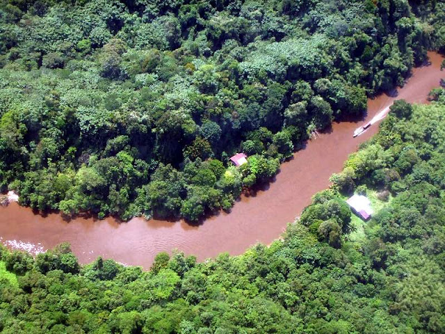 Flying over the Melinau River in Mulu