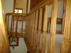 Carved teak wood stair posts
