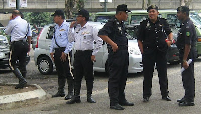 Traffic police milling around Pasar Seni together with regular police