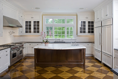 These two pictures are from a Peacock kitchen that is in a new spec home in  Greenwich. The floors are amazing! Notice the marble and soapstone  counters; ...