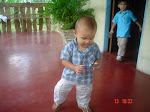 Gabriel learning to walk and eduart to the bottom