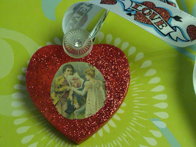 Wood heart decorated with glitter, vintage image, button and ribbon. DIY Decorated Wood Hearts - DearCreatives.com