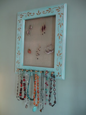 jewlery hanger - blue frame with pegs, mesh on inside for hanging earrings