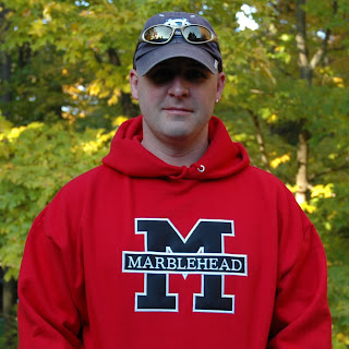 man wearing red sweatshirt with block letter M and Marblehead