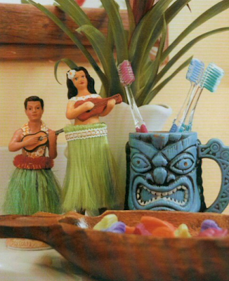 bathroom with souvenir mug holding toothbrushes