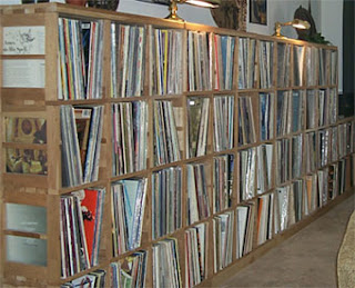 wall of storage boxes full of vinyl records