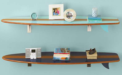 two surfboard wall shelves with items on them