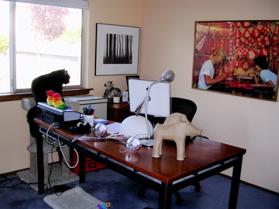 Jeri Dansky's home office with iMac, artwork, and cat