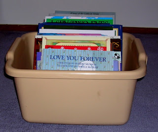 children's books stored in dishpan