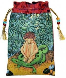 silk beg with picture of elf boy, green lizard, tropical vegetation