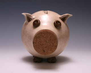 piggy bank with cork in snout