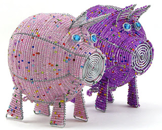 beaded piggy banks in pink and purple