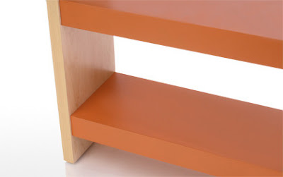 shelving with orange lacquer shelves