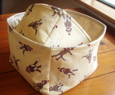 fabric basket with monkeys