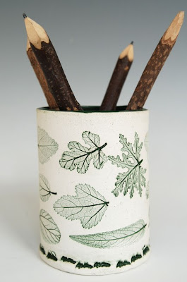 stoneware pencil cup, green leaves on white background