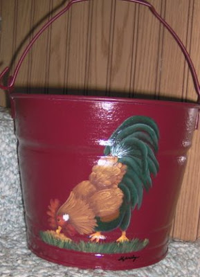 red bucket with rooster