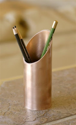copper pencil holder, holding 3 pencils