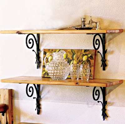 two shelves with elaborate brackets