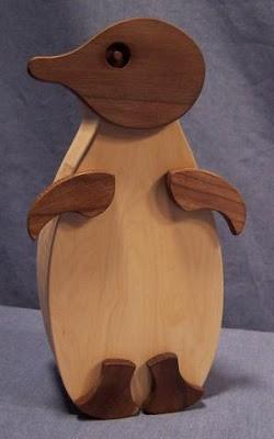 wooden penguin piggy bank